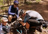 Colin, Dave, and a trail-side tire repair by Trek territory manager Karl Erbach