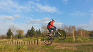 Wheelie drop off the stockade skinny at Lebanon Hills skills park