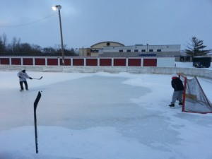 Jake and Christopher at a Northfield hockey rink
