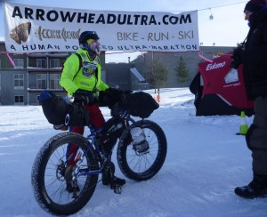 Christopher Tassava with bike at finish line - photo by David Sears