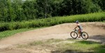 woman mountain biker on the berms at Lebanon Hills