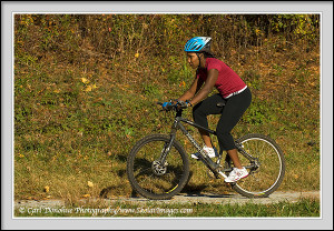 Woman mountain biking, Chattahoochee River, Atlanta, Georgia.