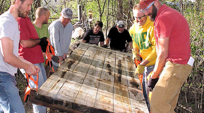 Two dozen volunteer trail workers install two bridges and reroute a trail in a week